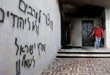 Photo of مستوطنون يحرقون مسجداً ويخطون شعارات عنصرية على جدرانه